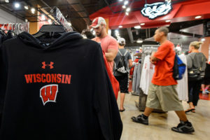 Badger fans shop for new apparel at Bucky's Locker Room inside Camp Randall.
